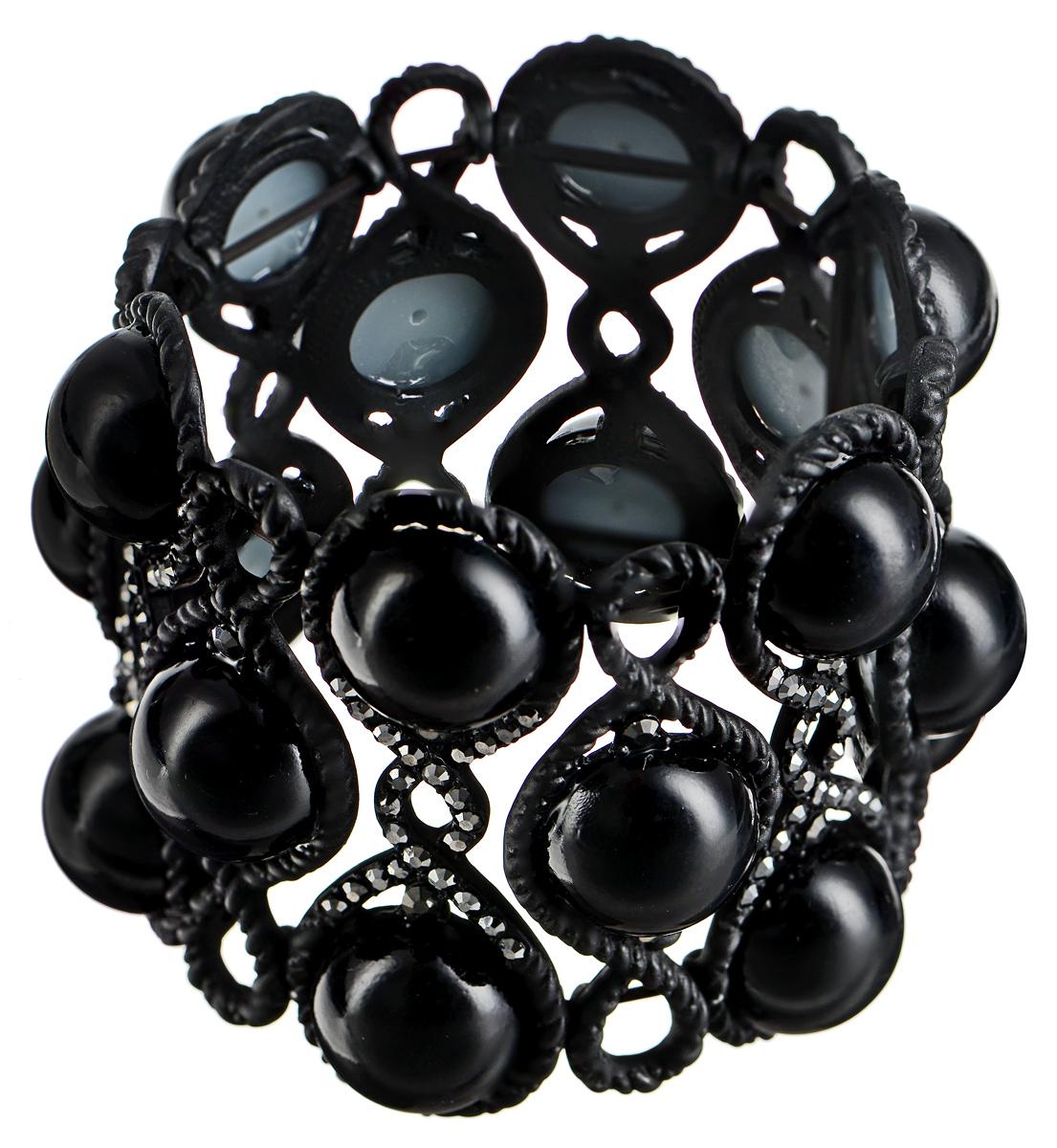 Браслет Taya, цвет: черный. T-B-7417T-B-7417-BRAC-BLACKСтильный браслет Taya выполнен из бижутерийного сплава. Элементы оригинальной формы оформлены вставками из полубусин и сияющих стразов. Благодаря эластичной основе и подвижным элементам изделие идеально разместиться на запястье. Такой браслет позволит вам с легкостью воплотить самую смелую фантазию и создать собственный, неповторимый образ.