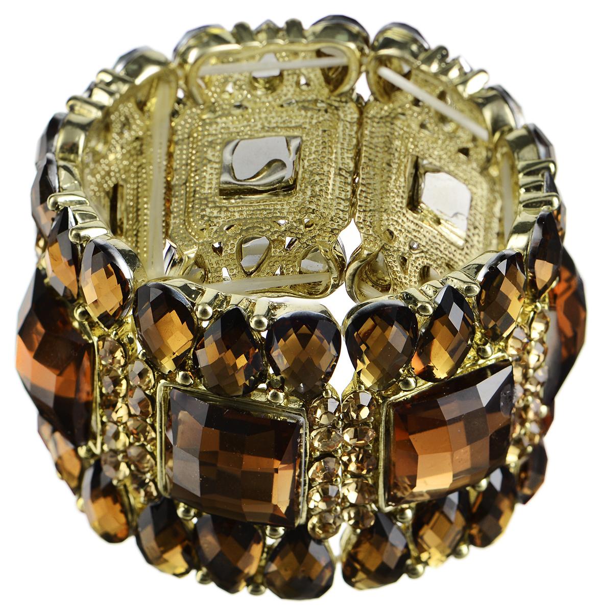 Браслет Taya, цвет: золотистый. T-B-7416T-B-7416-BRAC-GOLDСтильный браслет Taya выполнен из бижутерийного сплава и пластика. Элементы оригинальной формы оформлены вставками из сияющих стразов и граненых камней. Благодаря эластичной основе и подвижным элементам изделие идеально разместиться на запястье. Такой браслет позволит вам с легкостью воплотить самую смелую фантазию и создать собственный, неповторимый образ.