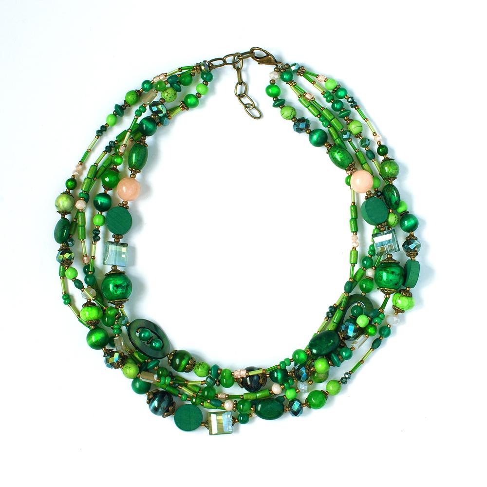 Ожерелье Selena Роман с Камнем-Индиго, цвет: зеленый. 1009784110097841Оригинальное ожерелье от Selena Роман с Камнем-Индиго представляет собой короткие многоярусные бусы, выполненные из полудрагоценного камня - варисцита, драгоценного камня - перламутра, а также из бусин палисандрового дерева, бисера и кристаллов Preciosa. Помимо, изделие дополнено декоративными металлическими элементами из бронзы. Ожерелье застегивается на карабин и оснащено цепочкой для регулирования размера. Такое ожерелье позволит вам с легкостью воплотить самую смелую фантазию и создать собственный, неповторимый образ.