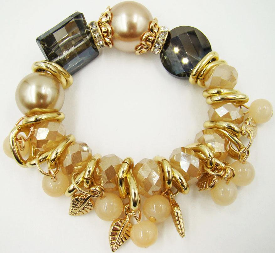 Браслет Taya, цвет: золотой, бежевый, серый. T-B-9969T-B-9969-BRAC-GOLDСтильный браслет Taya выполнен в виде основы из эластичной резинки, на которой размещены бусины из пластика, стекла и декоративные элементы из металлического сплава. Благодаря эластичной основе изделие идеально разместиться на запястье. Изящный браслет придаст вашему образу изюминку, подчеркнет красоту и изящество вечернего платья или преобразит повседневный наряд.