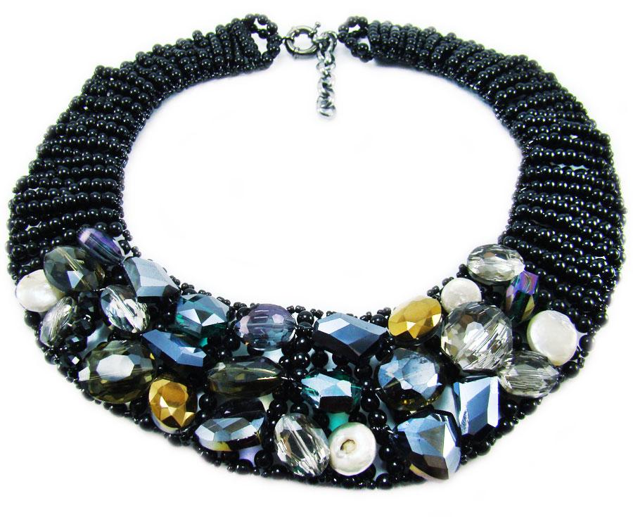 Ожерелье Taya, цвет: черный, мультиколор. T-B-884T-B-8845-NECK-BK.MULTIЭлегантное ожерелье Taya, выполнено в виде плетеной основы из пластиковых бусин и бисера. Изделие оформлено натуральными камнями, гранеными стеклянными и пластиковыми бусинами. Ожерелье застегивается на практичный шпренгельный замок, длина регулируется за счет дополнительных звеньев. Стильное ожерелье придаст вашему образу изюминку, подчеркнет индивидуальность.