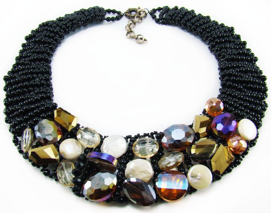 Ожерелье Taya, цвет: черный, мультиколор. T-B-884T-B-8846-NECK-BK.MULTIЭлегантное ожерелье Taya, выполнено в виде плетеной основы из пластиковых бусин и бисера. Изделие оформлено натуральными камнями, гранеными стеклянными и пластиковыми бусинами. Ожерелье застегивается на практичный шпренгельный замок, длина регулируется за счет дополнительных звеньев. Стильное ожерелье придаст вашему образу изюминку, подчеркнет индивидуальность.