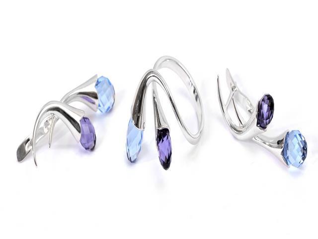 Комплект украшений Jenavi Пломбир: кольцо, серьги, цвет: серебристый, синий, фиолетовый. e151f240e151f240Очаровательный комплект украшений Jenavi Пломбир включает в себя стильное кольцо и серьги. Оригинальные серьги, выполненные из гипоаллергенного ювелирного сплава с серебристым покрытием, дополнены многогранными сверкающими кристаллами Сваровски. Серьги застегиваются на английский замок. Элегантное кольцо выполнено из гипоаллергенного ювелирного сплава с серебристым покрытием и декорировано двумя кристаллами Сваровски. Кольцо не имеет размера. Изящный комплект придаст вашему образу изюминку, подчеркнет красоту вечернего платья или преобразит повседневный наряд.