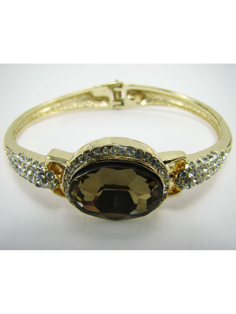 Браслет Taya, цвет: золотистый. T-B-7094T-B-7094Стильный женский браслет Taya выполнен из металлического сплава с покрытием под золото. Изделие украшено ограненым камнем из стекла и россыпью страз. Застегивается на пружинный замок. Такой оригинальный браслет не оставит равнодушной ни одну любительницу изысканных и необычных украшений, а также позволит с легкостью воплотить самую смелую фантазию и создать собственный, неповторимый образ.