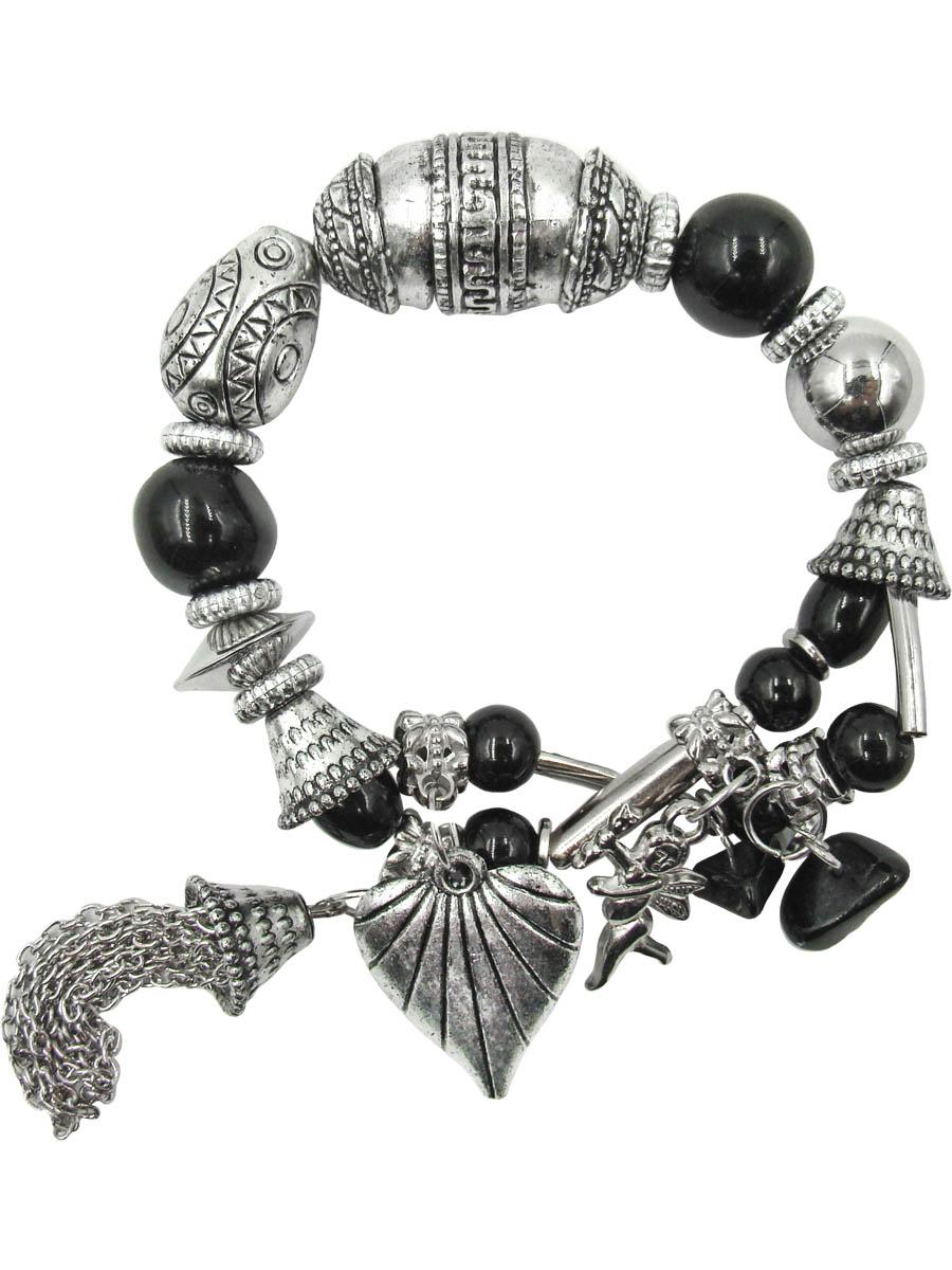 Браслет Taya, цвет: черный, серебристый. T-B-10334T-B-10334Оригинальный браслет Taya, изготовленный из гипоаллергенного материала, выполнен на эластичной основе из декоративных металлических элементов, бусин и камушков. Модель дополнена стильными подвесками из металла в виде сердца, ангела любви Амура и кисточек из цепочек. Такой оригинальный браслет не оставит равнодушной ни одну любительницу изысканных и необычных украшений, а также позволит с легкостью воплотить самую смелую фантазию и создать собственный, неповторимый образ.