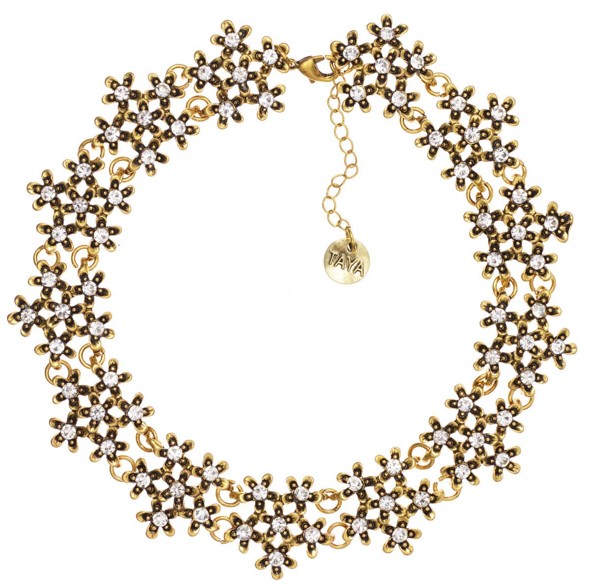Ожерелье Taya, цвет: бронзовый. T-BT-B-9886-NECK-BRONZEЭлегантное ожерелье Taya, выполнено из бижутерийного сплава. Изделие состоит из элементов в форме цветков, скрепленных между собой и дополненных вставками из стеклянных стразов. Ожерелье застегивается на практичный замок-карабин, длина регулируется за счет дополнительных звеньев. Стильное ожерелье придаст вашему образу изюминку, подчеркнет индивидуальность.