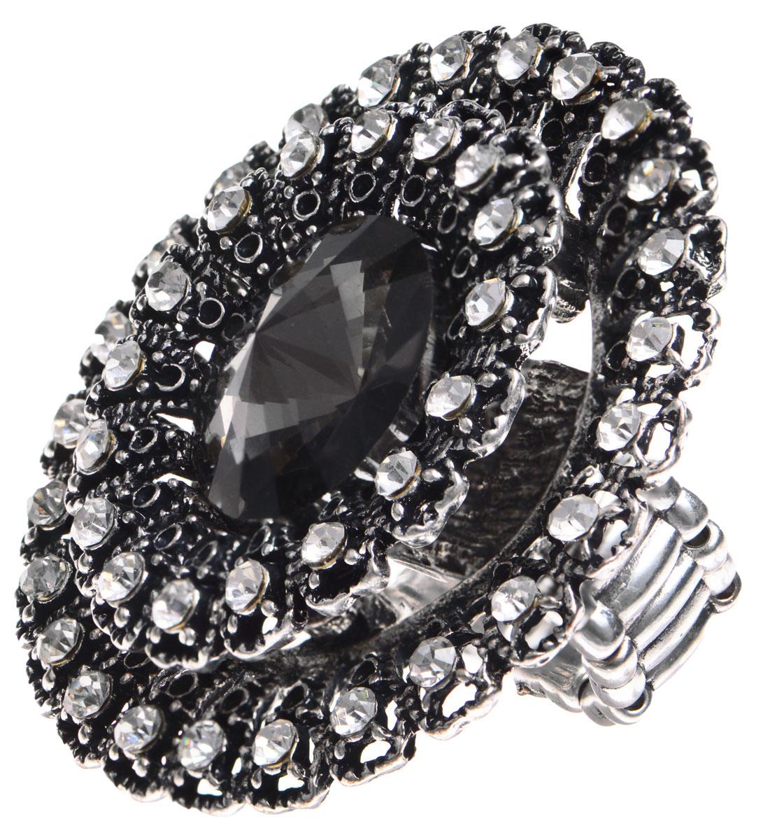 Кольцо Taya, цвет: серебристый. T-B-9264T-B-9264-RING-SILVERОригинальное кольцо Taya выполнено из бижутерийного сплава, дополнено декоративным элементом в виде цветка, каждый лепесток которого оформлен сверкающей вставкой из стекла. Сердцевина цветка украшена крупным граненым камнем. В основании изделия использована эластичная резинка, что делает размер кольца универсальным. Стильное кольцо придаст вашему образу изюминку, подчеркнет индивидуальность.