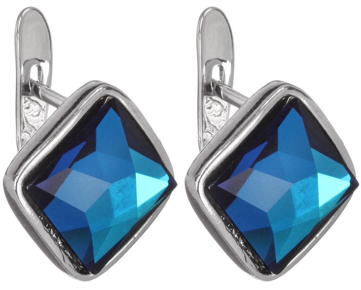 Серьги Jenavi Шедар, цвет: серебряный, голубой. b832f140b832f140Стильные серьги Jenavi Шедар в виде основы квадратной формы из ювелирного сплава, которая дополнена кристаллами Swarovski. В качестве основания используется классический английский замок, который надежно зафиксирует сережку. Оригинальные серьги Jenavi Шедар помогут дополнить любой образ и привнести в него завершающий яркий штрих.