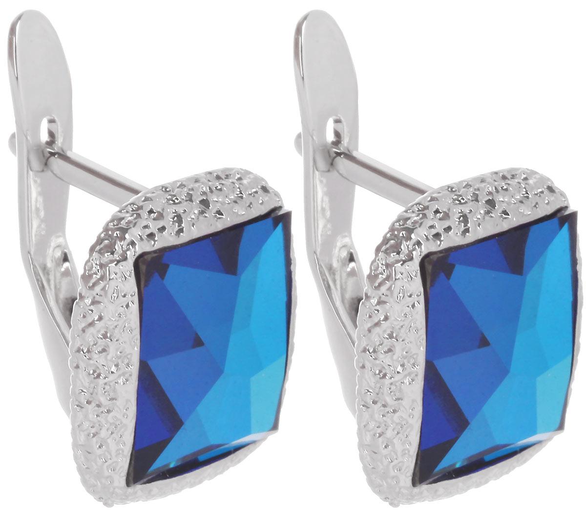 Серьги Jenavi Алудра, цвет: серебряный, голубой. b833f140b833f140Стильные серьги Jenavi Алудра в виде основы квадратной формы из ювелирного сплава, которая дополнена кристаллами Swarovski. В качестве основания используется классический английский замок, который надежно зафиксирует сережку. Оригинальные серьги Jenavi Алудра помогут дополнить любой образ и привнести в него завершающий яркий штрих.