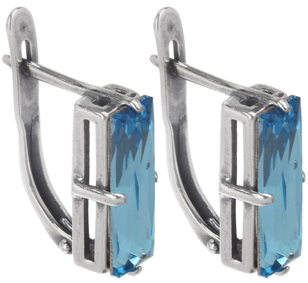 Серьги Jenavi Гармсиль, цвет: серебряный, голубой. e5163140e5163140Стильные серьги Jenavi Гармсиль выполнены в виде основы прямоугольной формы из ювелирного сплава, которая дополнена кристаллами Swarovski. В качестве основания используется классический английский замок, который надежно зафиксирует сережку. Оригинальные серьги Jenavi Гармсиль помогут дополнить любой образ и привнести в него завершающий яркий штрих.