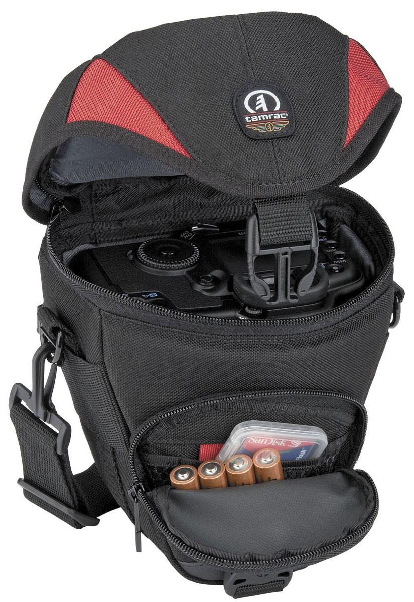 Tamrac 5514, Red Black сумка для фотоаппарата1401101231Tamrac 5514 - компактная сумка для пленочного 35 мм фотоаппарата с объективом, длина которого не превышает 7,6 см. Стенки сумки имеют внутреннюю прокладку из поролона. Наружный накладной карман вмещает вспышку и запасные плёнки; внутренний карман-сетка, предназначен для светофильтров, крышек от объективов и принадлежностей для чистки объектива. Наплечный ремень с изменяемой длиной позволяет носить сумку и на поясе.