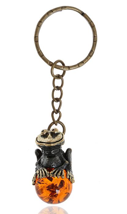 Брелок для ключей Лягушка на шарике. Янтарь, латунь. Россия, КалининградZAP-027Брелок для ключей Лягушка на шарике. Янтарь (прессованная янтарная крошка), латунь. Россия, Калининград. Размер - 5 х 2 см. Изделие оснащено кольцом для ключей. Изящный брелок порадует вас необычным дизайном и функциональностью, а также станет приятным подарком к любому празднику!