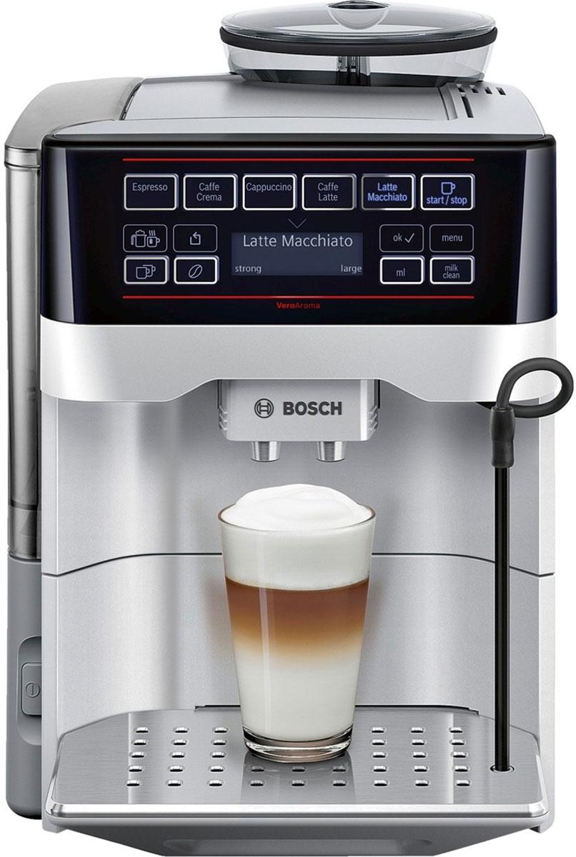 Bosch TES 60321RW VeroAroma кофемашинаTES 60321RWBosch TES 60321RW VeroAroma - это разнообразие вкусных кофейных напитков быстро и просто. Нажатием одной кнопки вы приготовите выбранный рецепт сразу в две чашки: для себя и друга Эта кофемашина подарит вам многообразие рецептов приготовления кофе: эспрессо, кафе крема, капучино, кафе латте, латте макиато и многих других. Изысканные напитки готовятся вкусно и быстро. Инновационный проточный нагреватель Intelligent Heater inside обеспечивает правильную температуру заваривания кофе и полноценный аромат благодаря технологии SensoFlowSystem. Система MilkClean делает необыкновенно простой чистку молочной системы: достаточно просто нажать одну кнопку. Гигиенично, быстро и просто. Bosch TES 60523RW VeroAroma оснащена CeramDrive - высококачественной керамической мельницей, сделанной из износостойкой керамики. Функция OneTouch - приготовление напитков одним нажатием кнопки AromaDoubleShot приготовление напитка двойной крепости ...