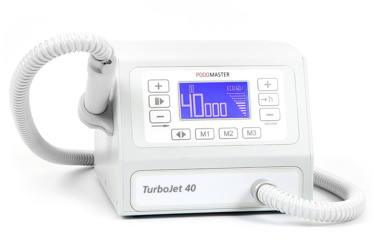 Евромедсервис Педикюрный аппарат с пылесосом Podomaster TurboJet 40 (40 тыс. об/мин)793Аппарат для педикюра Podomaster TurboJet 40 предназначен для проведения процедур педикюра с одновременным удалением пыли в специальный мешок при помощи встроенного пылесоса. Скорость вращения аппарата — 40 000 оборотов в минуту. Функции: 3 ячейки памяти скорости вращения, счетчик часов работы для своевременной замены фильтра, плавная регулировка оборотов, реверс, функция паузы, регулировка мощности пылесоса, цифровой дисплей, возможность подключения педали плавной регулировки оборотов (опция). Отличительные особенности: бесщеточный мотор в наконечнике, большой экран, регулировка всех настроек при помощи клавиатуры, ультралегкий наконечник, выключатель на ручке, боковой держатель для наконечника, силиконовый колпачок против попадания пыли в выключатель. Боковой держатель для наконечника может устанавливаться как на левую, так и на правую сторону аппарата.