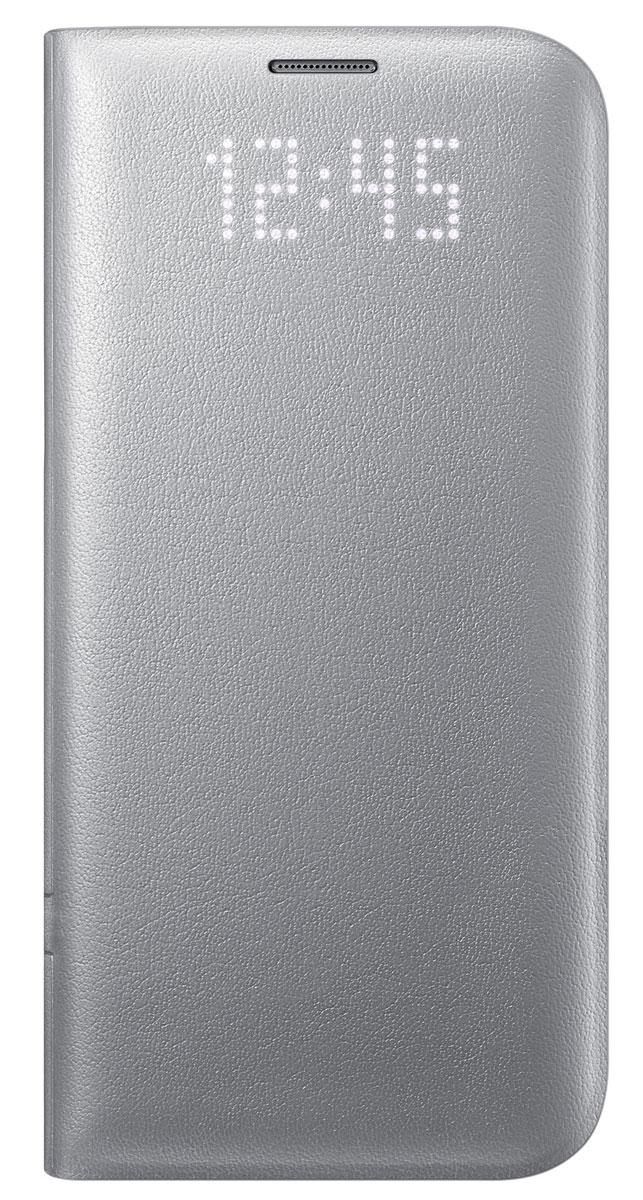 Samsung EF-NG935 LED View Cover чехол для Galaxy S7 Edge, SilverEF-NG935PSEGRUЧехол Samsung EF-NG935 LED View Cover выглядит как обыкновенный чехол, но стоит вам получить уведомление, как оно моментально отобразится на его лицевой поверхности. Главной особенностью чехла является встроенный светодиодный дисплей, позволяющий посмотреть время или проверить уровень заряда аккумулятора не раскрывая чехол. Вы также можете присвоить специальные иконки различным контактам, чтобы моментально определить, кто вам звонит. Достаточно просто провести пальцем по поверхности чехла, где размещён светодиодный дисплей, чтобы принять или сбросить входящий вызов, выключить будильник или таймер. Дизайн чехла ещё никогда не был настолько продуман. Экран смартфона моментально включится, как только вы откроете чехол, и погаснет сразу как вы его закроете. Помимо этого, внутри имеется специальное отделение, которое можно использовать для хранения визиток или банковских карт.