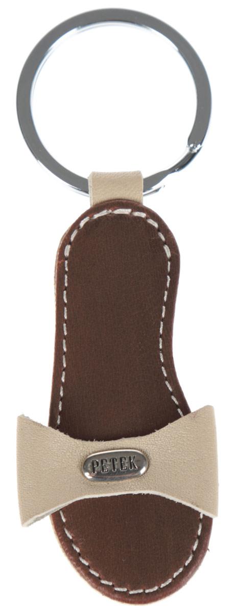 Брелок женский Petek 1855, цвет: коричневый, бежевый. 1517.000.041517.000.04 L.BrownСтильный брелок для ключей Petek 1855 выполнен из натуральной кожи с декоративным тиснением. Брелок в виде туфельки оформлен небольшой металлической пластиной с гравировкой в виде логотипа производителя и оснащен металлическим кольцом. Изделие поставляется в фирменной упаковке. Брелок Petek 1855 порадует вас необычным дизайном и функциональностью, а также станет приятным подарком к любому празднику!