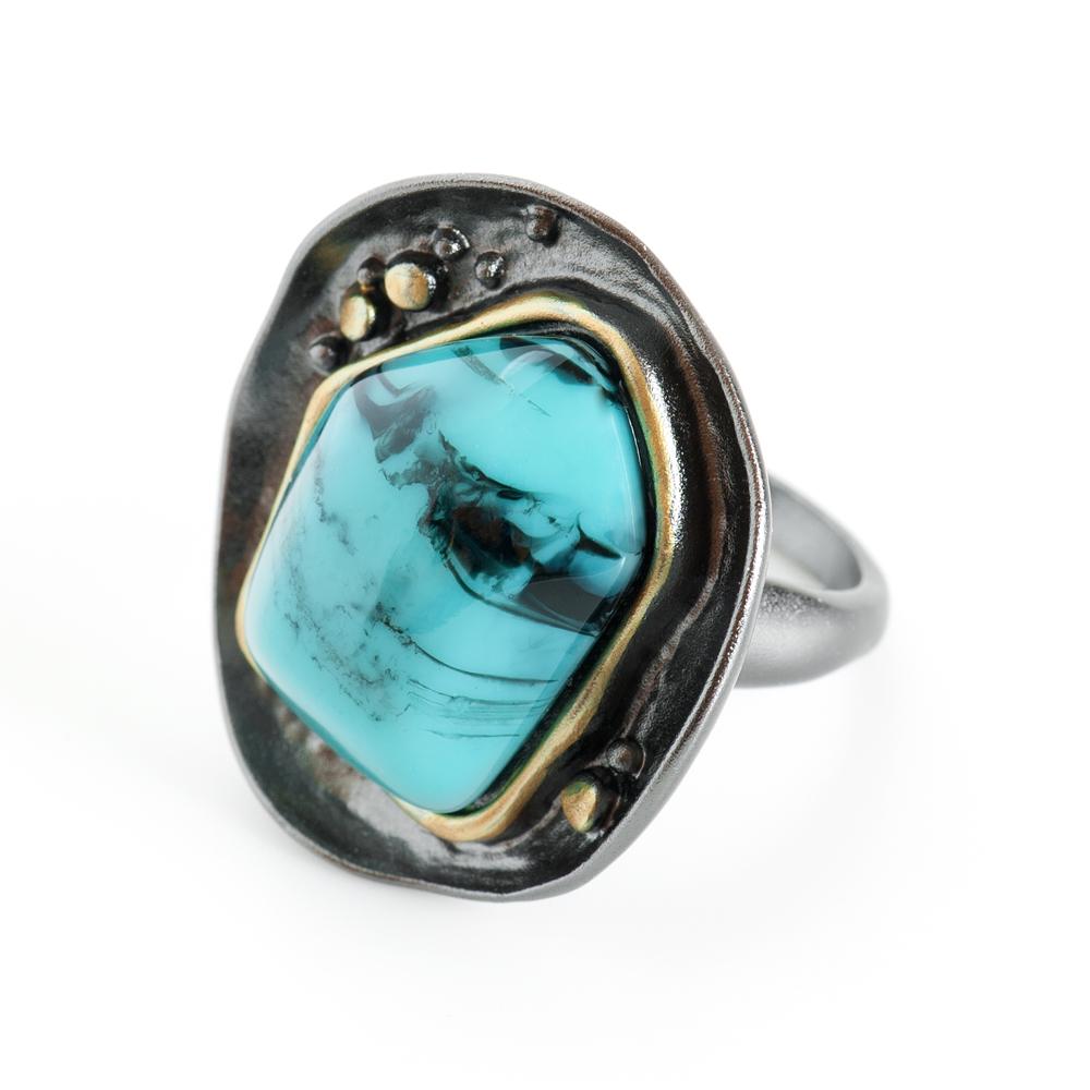 Кольцо Selena Valencia, цвет: бирюзовый, золотистый, черный. 60025248. Размер 1860025248Ювелирная смола, латунь. Гальваническое покрытие: черненый родий, золото., размер 18
