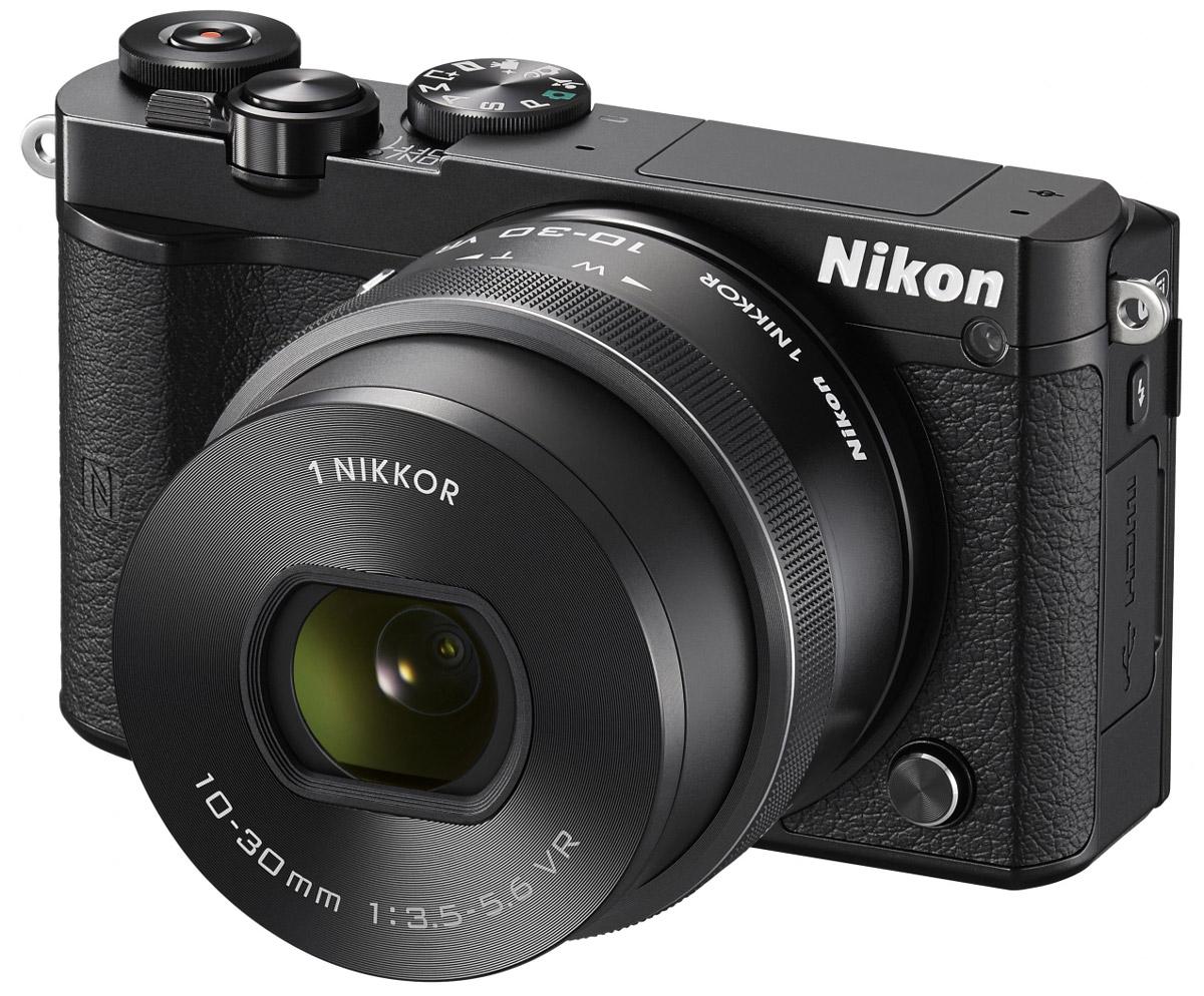 Nikon 1 J5 Kit 10-30 VR, Black цифровая фотокамераVVA241K001Бросьте вызов обыденности с ультрапортативной системной фотокамерой Nikon 1 J5. Создавайте захватывающие 20,8-мегапиксельные изображения и удивительно резкие видеоролики с разрешением 4K. Благодаря исключительной скорости съемки, которая даже выше, чем у цифровых зеркальных фотокамер, вы не упустите интересный кадр. Ваши снимки будут выгодно отличаться от фотографий, снятых при помощи смартфонов, благодаря разрешению 20,8 мегапикселя. Фотокамера Nikon 1 J5 оснащена большой КМОП-матрицей и может использоваться с объективами 1 NIKKOR. Это отличный инструмент для реализации самых смелых творческих замыслов. При скорости 20 кадров в секунду с непрерывной автофокусировкой портативная фотокамера Nikon 1 J5 позволяет снимать сюжеты, недоступные даже для цифровой зеркальной фотокамеры. Благодаря режиму Спорт вы сможете запечатлеть самые стремительные движения и не упустите ни одного важного момента. Записывайте видеоролики сверхвысокой резкости...