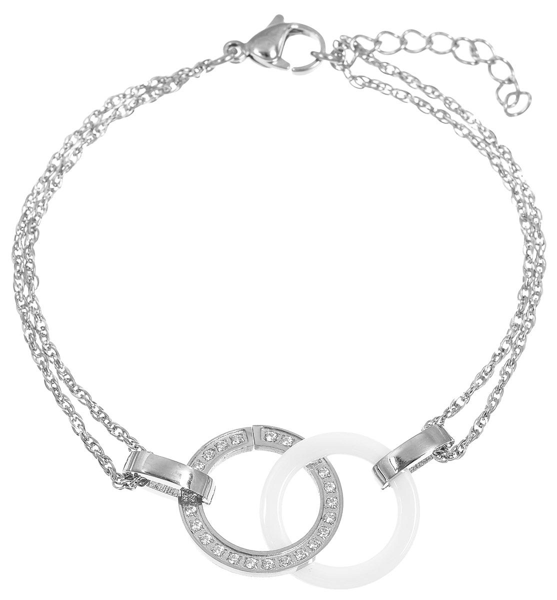 Браслет Art-Silver, цвет: серебряный, белый. КБ0818-821КБ0818-821Лаконичный женский браслет Art-Silver выполнен из бижутерного сплава, стали и керамики. Модель представляет собой основу из тонкой двойной цепочки с оригинальным плетением, соединенной двумя кольцами. Одно кольцо выполнено из керамики белого цвета, второе из стали и дополнено цирконами. Браслет застегивается при помощи застежки-карабина с регулирующей длину цепочкой. Необычный браслет блестяще подчеркнет ваш изысканный вкус и поможет внести разнообразие в привычный образ.