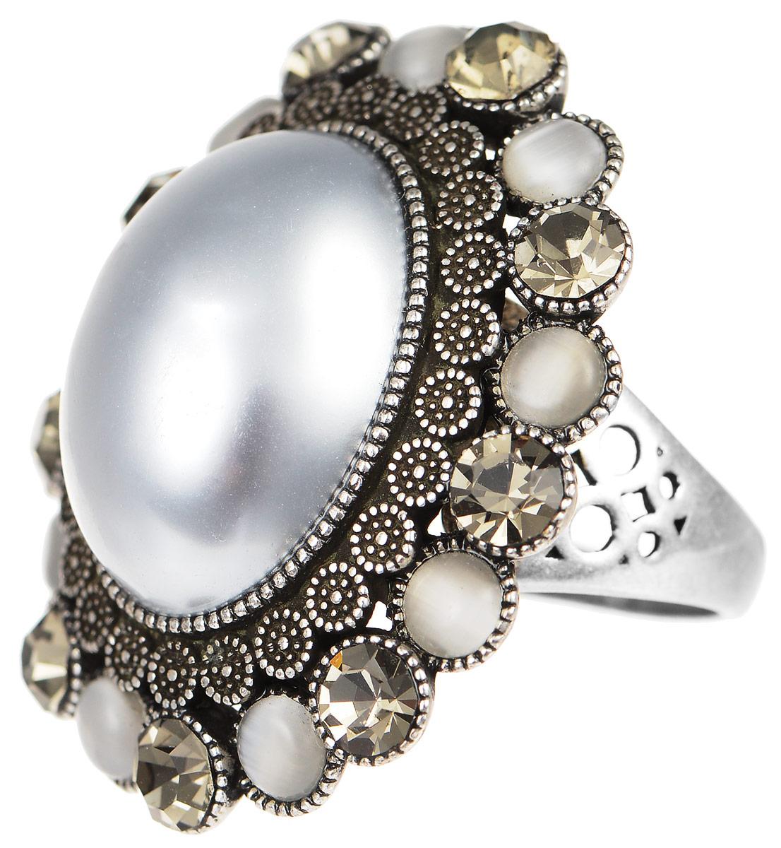Кольцо Art-Silver, цвет: серебристый, серый, серебристо-синий. 064458-803-821. Размер 18064458-803-821Великолепное кольцо Art-Silver изготовлено из бижутерного сплава. Изделие дополнено цирконами и натуральными камнями кошачий глаз. В центре кольцо украшает искусственный жемчуг Майорика. Отверстие кольца оформлено декоративной перфорацией. Стильное кольцо придаст вашему образу изюминку и подчеркнет индивидуальность.
