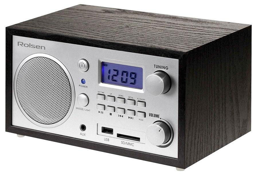 Радиобудильник Rolsen RFM-300, Wenge1-RLDB-RFM-300Rolsen представляет серию радиоприемников, которые удачно впишутся в интерьер вашей квартиры. Радиоприемник оснащен цифровым тюнером для настройки устройства на нужную волну. Такой тюнер позволяет точнее задать значение частоты, а также может осуществлять автоматический поиск и запоминать избранные станции. Радиоприемники Rolsen – идеальное решение для практичных людей.