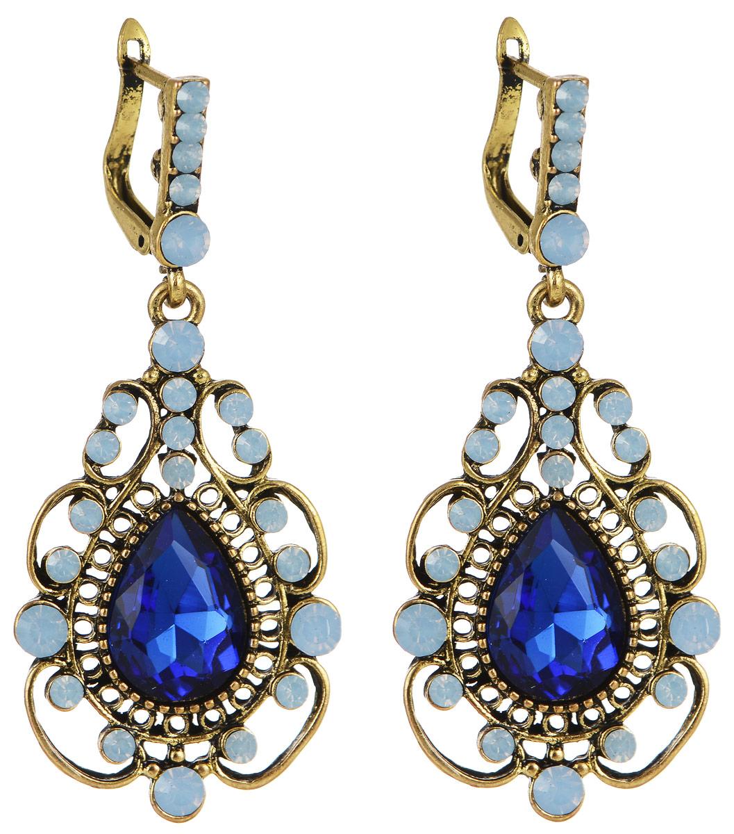 Серьги Taya, цвет: золотистый, темно-синий, голубой. T-B-11292T-B-11292-EARR-GL.D.BLUEСтильные серьги современного дизайна Taya изготовлены из металлического сплава, модель не оставит равнодушной ни одну любительницу изысканных и необычных украшений. Серьги выполнены в виде оригинальных витых подвесок, украшенных каплевидным камнем и россыпью мелких камней. Серьги застегиваются на английский замок. Такие серьги помогут дополнить любой образ и привнести в него завершающий яркий штрих.