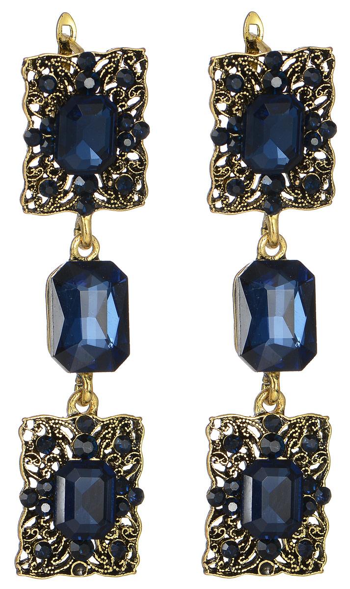 Серьги Taya, цвет: золотистый, темно-синий. T-B-11321T-B-11321-EARR-GL.D.BLUEИзящные серьги современного дизайна Taya изготовлены из металлического сплава, модель не оставит равнодушной ни одну любительницу изысканных и необычных украшений. Серьги выполнены в виде оригинальных подвесок инкрустированных стразами и дополненные крупными камнями. Серьги застегиваются на английский замок. Такие серьги позволят вам с легкостью воплотить самую смелую фантазию и создать собственный, неповторимый образ.