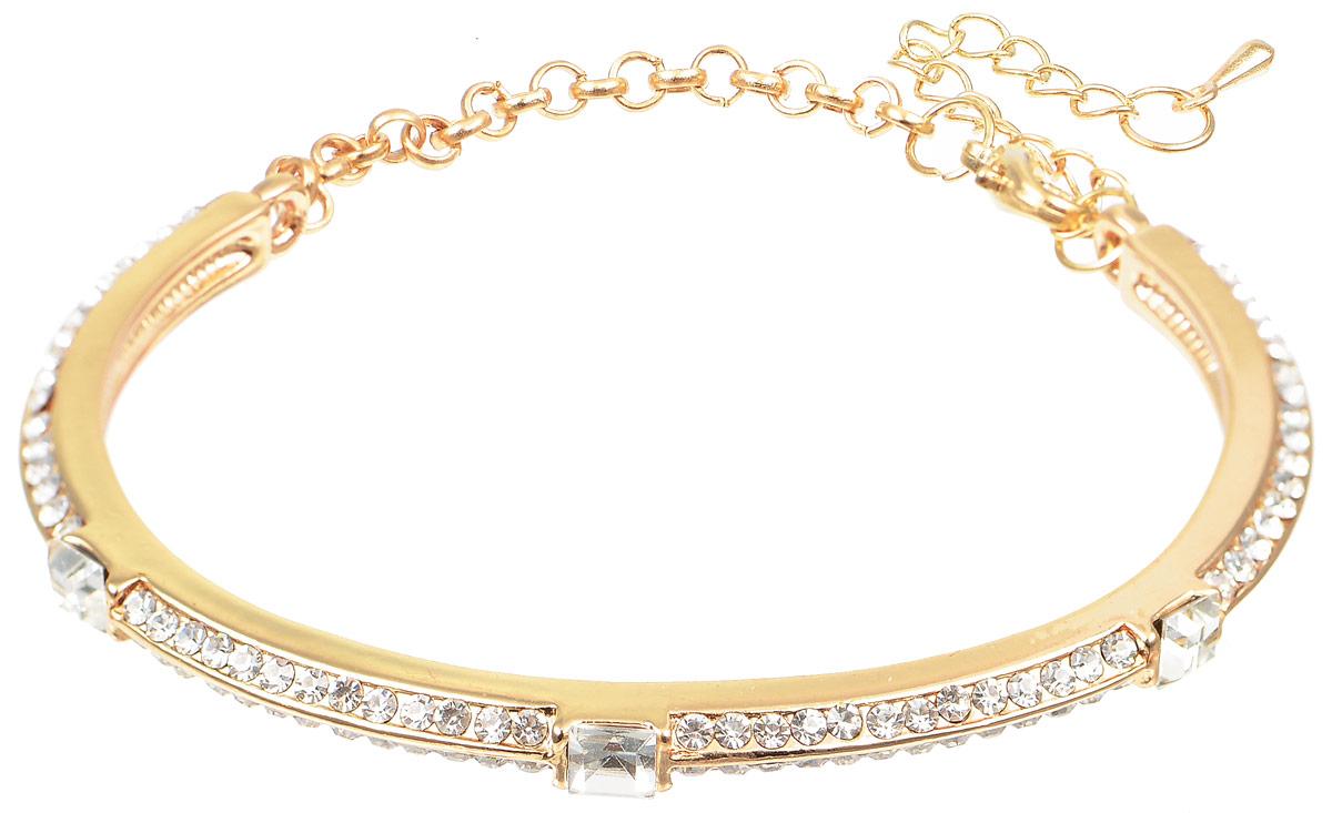 Браслет Taya, цвет: золотистый. T-B-10808T-B-10808-BRAC-GOLDИзысканный браслет Taya изготовлен из металлического сплава. Браслет представляет собой жесткую дугу, украшенную кристаллами и стразами. Изделие дополнено цепочкой, что позволяет регулировать размер браслета. Такой браслет позволит вам быть оригинальной, изящной и создать свой неповторимый образ. Красивое и необычное украшение блестяще подчеркнет изысканный вкус, женственность и красоту своей обладательницы и поможет внести разнообразие в привычный образ.