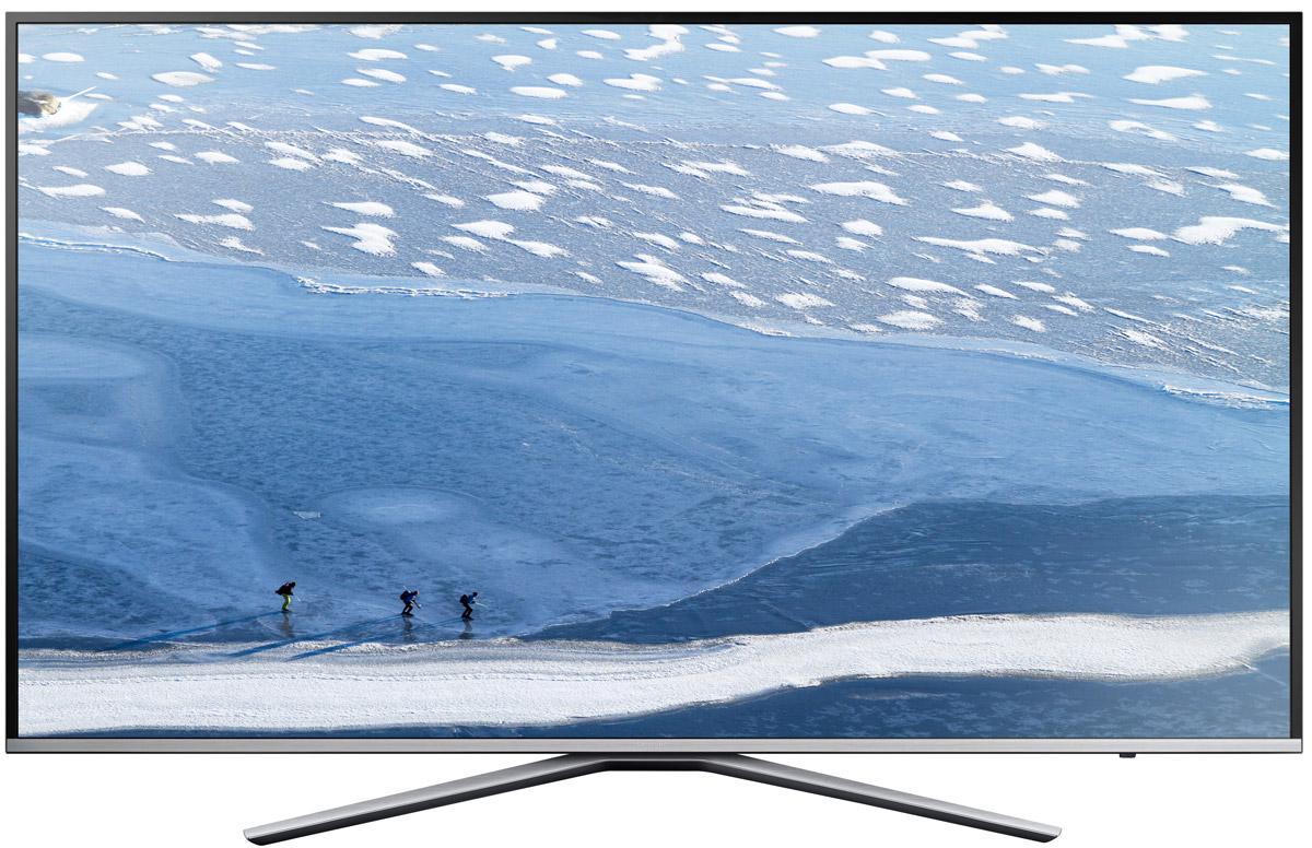 Samsung UE49KU6400UX телевизорUE49KU6400UXRUТелевизор Samsung UE49KU6400UX, благодаря современной технологии подсветки LED, обладает чрезвычайно малой толщиной экрана, а сочетание с утонченным дизайном позволяет телевизору удачно вписаться в любой интерьер. Встроенный DVB-T2/CS2 тюнер дает возможность приема спутниковых каналов в цифровом качестве.