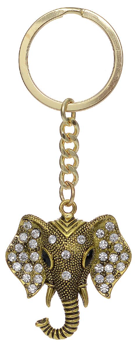 Брелок женский Mitya Veselkov, цвет: золотой. BRELOK-SLON-BLABRELOK-SLON-BLAОригинальный брелок для ключей Mitya Veselkov изготовлен из металла. Объемный декоративный элемент выполнен в виде головы слона, украшенной стразами. Замок брелока представлен в виде заводного кольца. Мелочей в образе не бывает, поэтому внимания требуют даже брелоки для ключей, ведь так приятно открывать дверь любимого дома ключом с красивым брелоком.