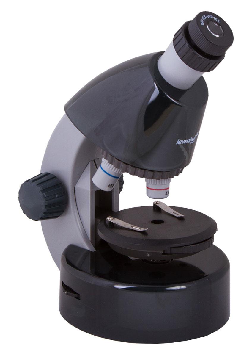 Levenhuk LabZZ M101, Moonstone микроскопXSP-1508 Pantone #432C Transp.Как выглядят безобидные букашки при большом увеличении, из чего состоят растения, кого можно увидеть в капле обычной воды - с микроскопом Levenhuk LabZZ M101 ваш ребенок сможет найти ответы на эти и многие другие вопросы. В комплекте есть все, что нужно для первого знакомства с микромиром - готовые образцы для изучения, специальные инструменты для работы с микроскопическими объектами и подробное руководство по проведению интереснейших опытов. Микроскоп создан специально для детей, но по уровню оптики он не уступает некоторым взрослым моделям. Прибор снабжен тремя объективами, причем для смены объектива не нужно прерывать занятия - достаточно повернуть револьверное устройство. Уникальная особенность этого микроскопа - выдвижной двухпозиционный окуляр. Такой окуляр заменяет собой два окуляра с увеличением 10 и 16 крат, а пользоваться им очень просто. Кроме того, ребенку не придется менять окуляры, а значит, они не потеряются. Три объектива и окуляр...