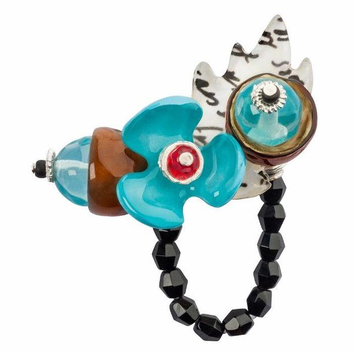 Кольцо Lalo Treasures G&G, цвет: светло-бирюзовый, коричневый. R6984mR6984mИзысканное кольцо оригинального дизайна Lalo Treasures изготовлено из ювелирной смолы ярких цветов. Изделие выполнено в виде утонченного цветка. Скругленные углы элемента идеально подходят для нежных женских пальцев - изящество и сама элегантность. Очень винтажно смотрится на руке. Кольцо Lalo подчеркнет вашу утонченность и изысканный вкус. Изделие регулируется по размеру.