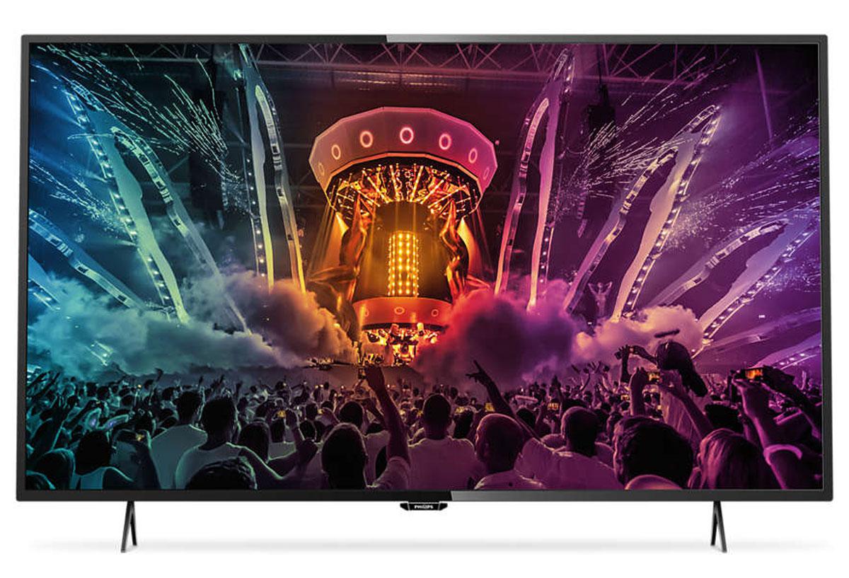 Philips 49PUT6101, Black телевизор49PUT6101/60Утонченные линии подчеркивают изящность дизайна Изящный, современный, лаконичный дизайн. Неудивительно, что ультратонкий силуэт телевизора Philips 49PUT6101 притягивает к себе взгляд — это идеальное решение, которое прекрасно дополнит любой интерьер. 4K Ultra HD: непревзойденное качество изображения в высоком разрешении Телевизор Philips 49PUT6101 Ultra HD в 4 раза превосходит разрешение обычного телевизора Full HD. Благодаря 8 миллионам пикселей и уникальной технологии Ultra Resolution качество изображения не будет зависеть от исходного контента. Улучшенная четкость и глубина изображения, великолепный контраст, плавное и естественное движение и безупречная детализация. Smart TV: исследуйте для себя совершенно новый мир Откройте для себя интеллектуальные возможности этого телевизора. Настраивайте потоковую передачу фильмов, видео или игр, приобретая их в онлайн-магазинах. Просматривайте прошедшие передачи с любимых телеканалов и...