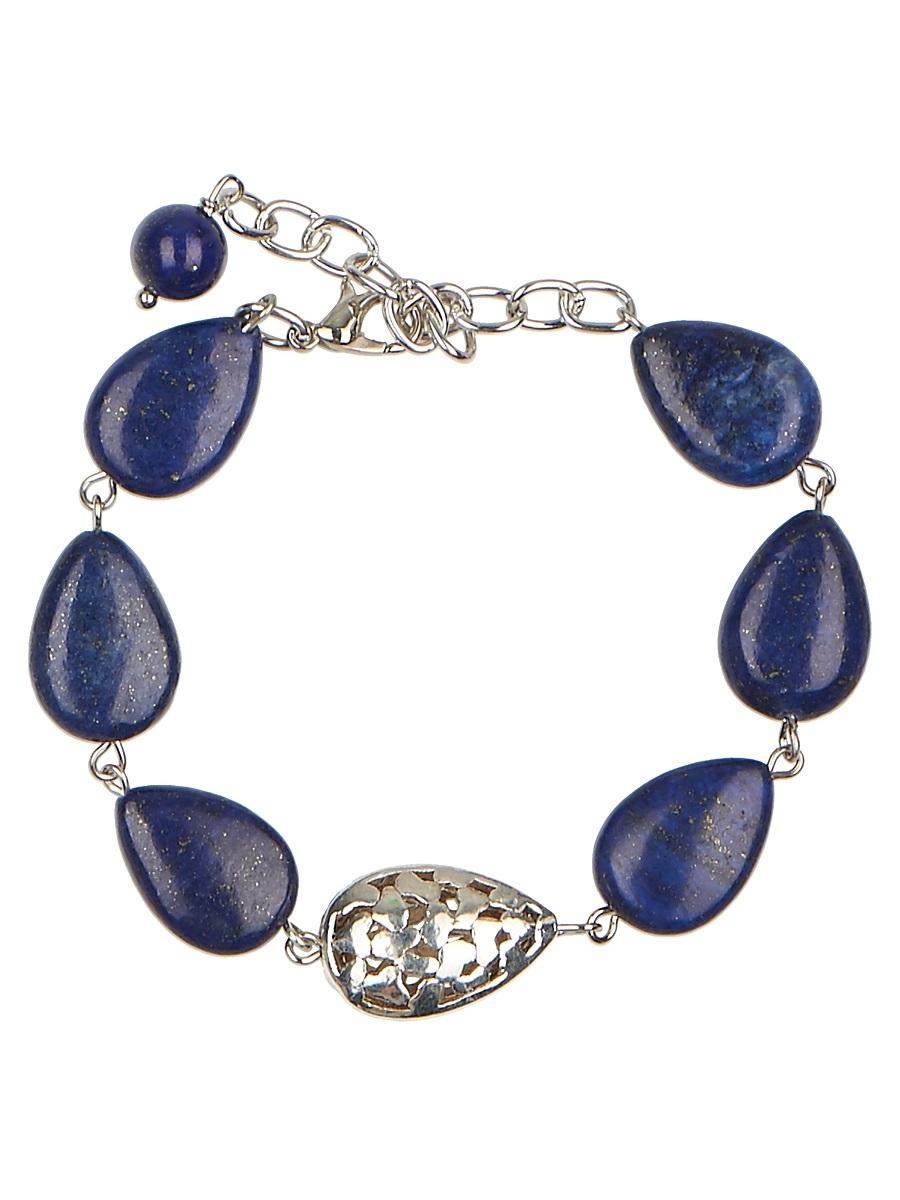 Браслет Polina Selezneva Миндаль, цвет: синий. 002-2963002-2963Браслет Миндаль выполнен из лазурита миндалевидной формы, по центру изделия расположена изящная резная фурнитура серебристого цвета, повторяющая форму камней.