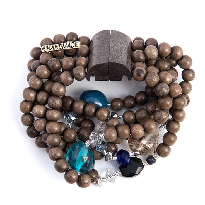 Браслет Selena Enigma, цвет: бирюзовый, коричневый, синий. 4005014040050140Пальмовое дерево, ювелирная смола, ювелирное стекло. Гальваническое покрытие: родий, длина колье 22 см ширина 5 см