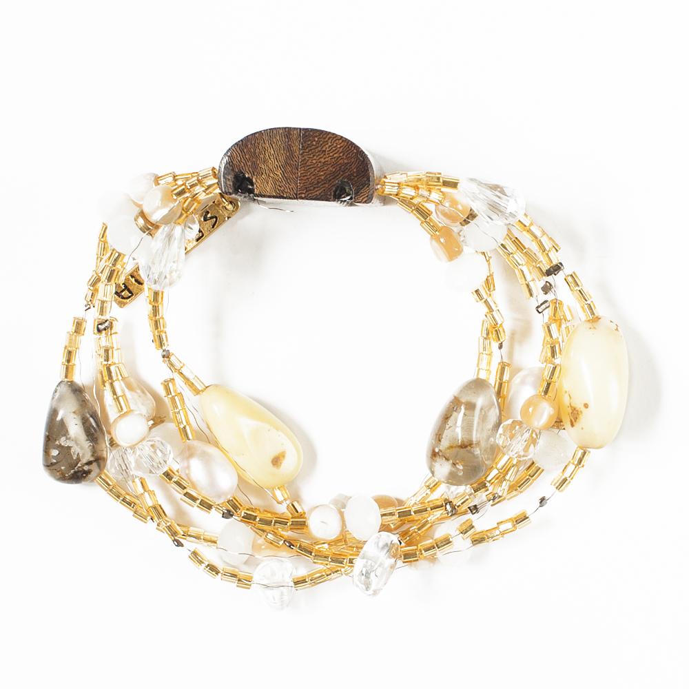 Браслет Selena Enigma, цвет: бежевый, золотистый, коричневый. 4005483040054830Ювелирная смола, пальмовое дерево, искусственный жемчуг, бисер, кристаллы Preciosa, длина браслета 22 см ширина 3,5 см