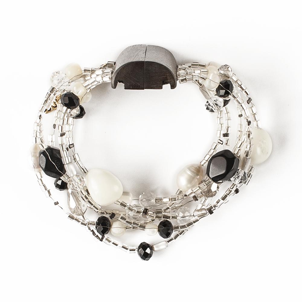 Браслет Selena Enigma, цвет: белый, коричневый, черный. 4005484040054840Ювелирная смола, пальмовое дерево, искусственный жемчуг, перламутр, бисер, кристаллы Preciosa, длина браслета 22 см ширина 4 см