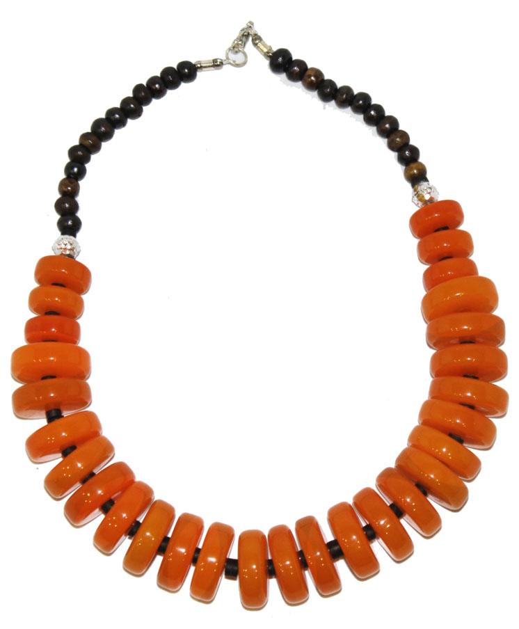 Бусы Ethnica, цвет: оранжевый. 350150350150-оранжевыйРоскошные бусы от Ethnica выполнены в виде колец разного диаметра. Изделие застегивается на замок-карабин.