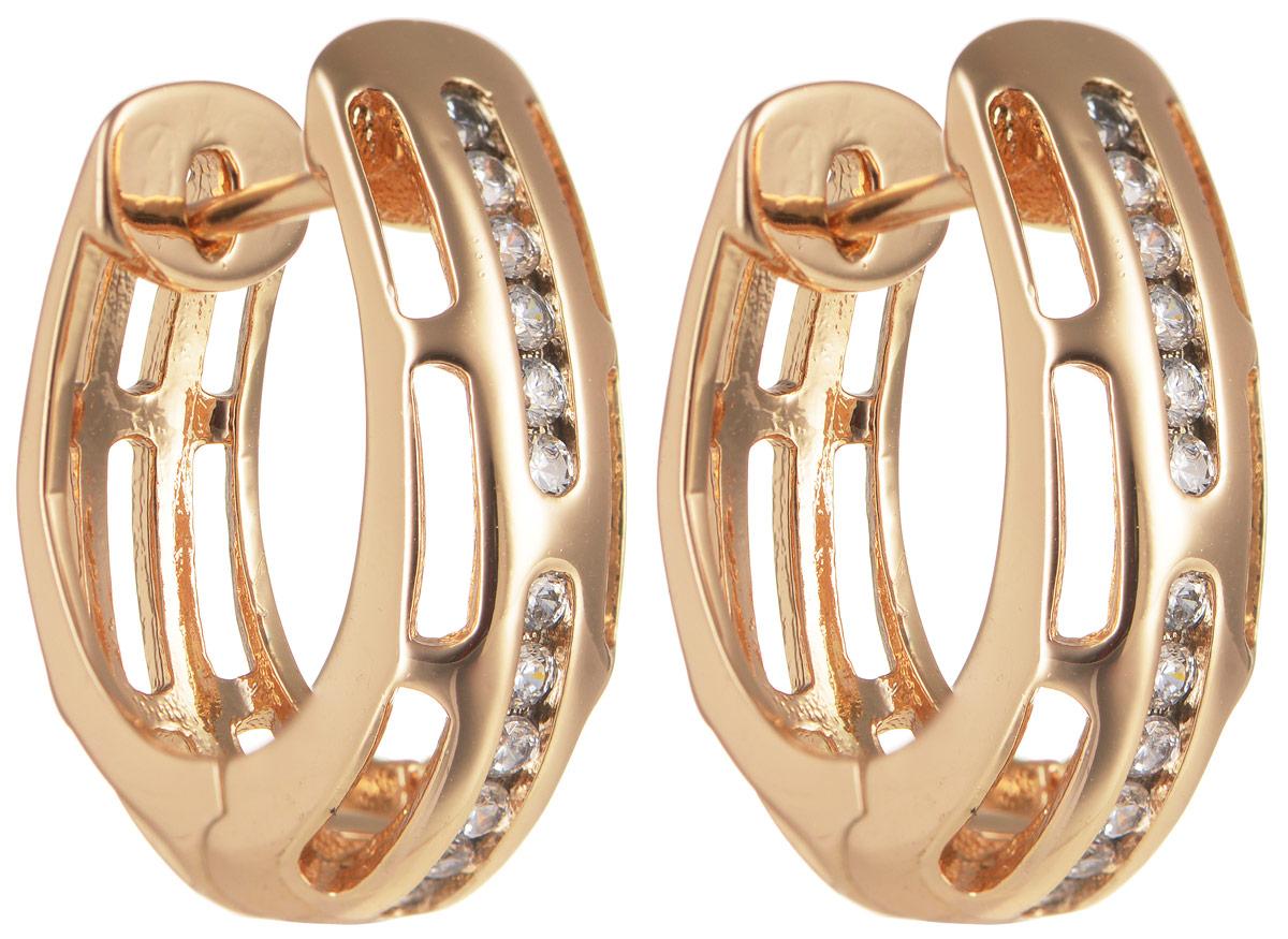 Серьги Taya, цвет: золотистый. T-B-11641T-B-11641-EARR-GOLDОригинальные позолоченные серьги Taya изготовлены из бижутерного сплава и оформлены цирконами. Застегивается изделие с помощью замка-конго. Серьги Taya блестяще подчеркнут ваш стиль и помогут внести разнообразие в привычный образ.
