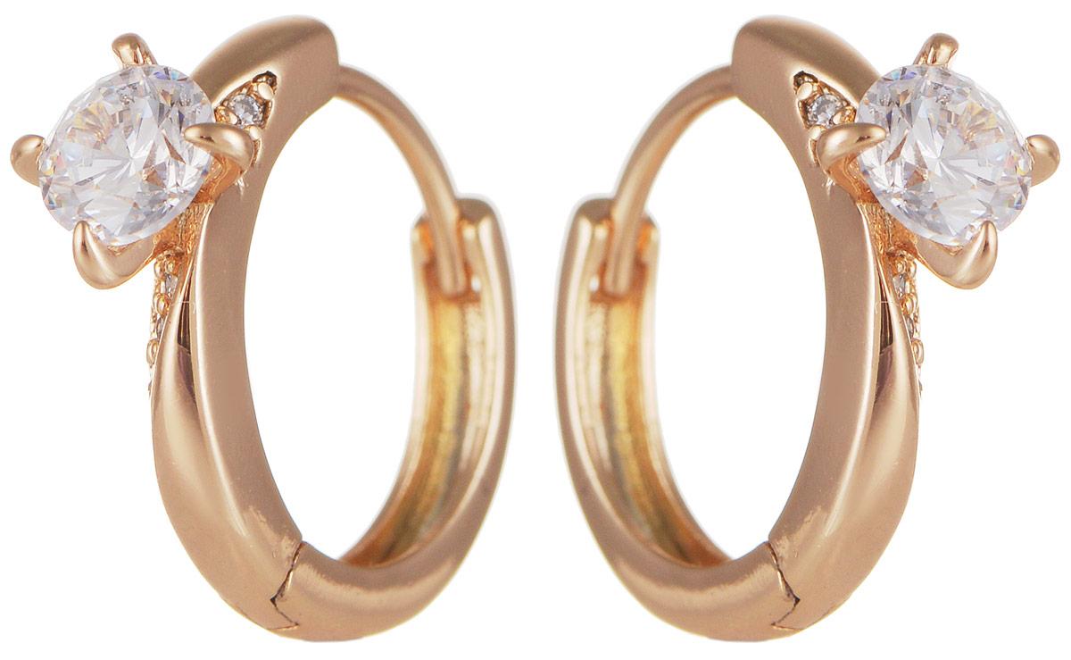 Серьги Taya, цвет: золотистый. T-B-11706T-B-11706-EARR-GOLDМодные позолоченные серьги Taya изготовлены из бижутерного сплава и оформлены большим цирконом. Застегивается изделие с помощью замка-конго. Оригинальные серьги внесут изюминку, как в повседневный, так и в выходной образ и позволят выделиться среди окружающих.