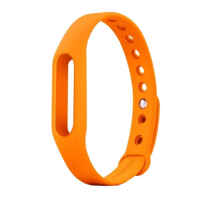Xiaomi сменный ремешок для Mi Band, OrangeMYD4033CNОригинальный сменный ремешок для фитнес-браслета Xiaomi Mi Band ярко-желтого цвета изготовлен гипоаллергенного силикона и придаст вашему образу индивидуальности, а также прекрасно подойдет к вашему гаджету!