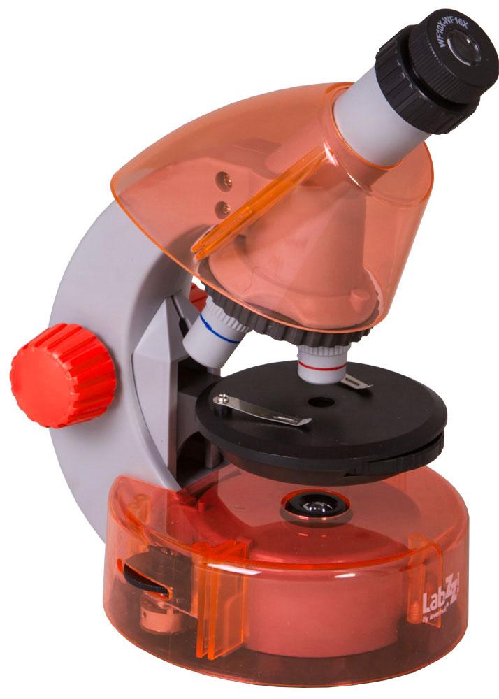 Levenhuk LabZZ M101, Orange микроскопXSP-1508 Pantone#179C OrangeКак выглядят безобидные букашки при большом увеличении, из чего состоят растения, кого можно увидеть в капле обычной воды - с микроскопом Levenhuk LabZZ M101 ваш ребенок сможет найти ответы на эти и многие другие вопросы. В комплекте есть все, что нужно для первого знакомства с микромиром - готовые образцы для изучения, специальные инструменты для работы с микроскопическими объектами и подробное руководство по проведению интереснейших опытов. Микроскоп создан специально для детей, но по уровню оптики он не уступает некоторым взрослым моделям. Прибор снабжен тремя объективами, причем для смены объектива не нужно прерывать занятия - достаточно повернуть револьверное устройство. Уникальная особенность этого микроскопа - выдвижной двухпозиционный окуляр. Такой окуляр заменяет собой два окуляра с увеличением 10 и 16 крат, а пользоваться им очень просто. Кроме того, ребенку не придется менять окуляры, а значит, они не потеряются. Три объектива и окуляр...
