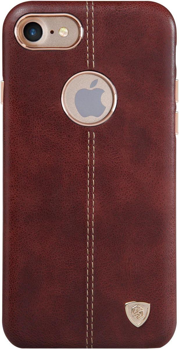 Nillkin Englon Leather Cover чехол для Apple iPhone 7, Brown2000000100241Чехол Nillkin Englon для Apple iPhone 7 надежно защищает ваш смартфон от внешних воздействий, грязи, пыли, брызг. Он также поможет при ударах и падениях, не позволив образоваться на корпусе царапинам и потертостям. Внутри чехла встроена магнитная площадка для крепления к магнитным держателям. Чехол обеспечивает свободный доступ ко всем функциональным кнопкам смартфона и камере.