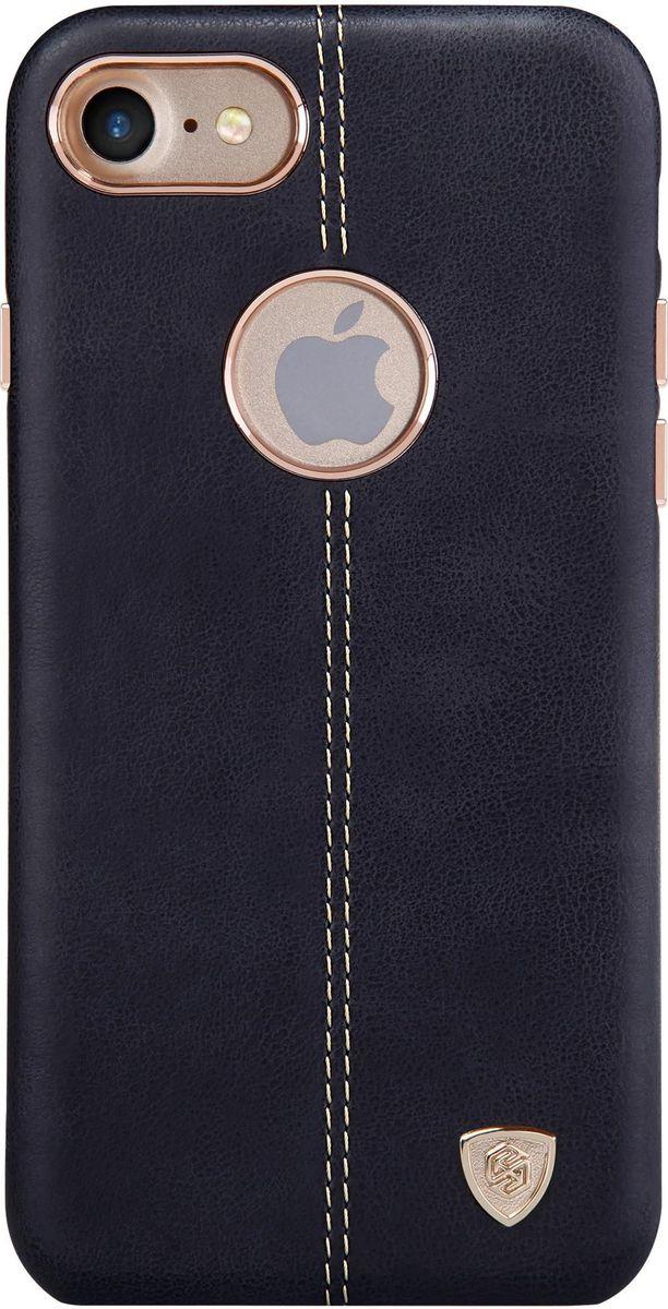 Nillkin Englon Leather Cover чехол для Apple iPhone 7, Black2000000100272Чехол Nillkin Englon для Apple iPhone 7 надежно защищает ваш смартфон от внешних воздействий, грязи, пыли, брызг. Он также поможет при ударах и падениях, не позволив образоваться на корпусе царапинам и потертостям. Внутри чехла встроена магнитная площадка для крепления к магнитным держателям. Чехол обеспечивает свободный доступ ко всем функциональным кнопкам смартфона и камере.