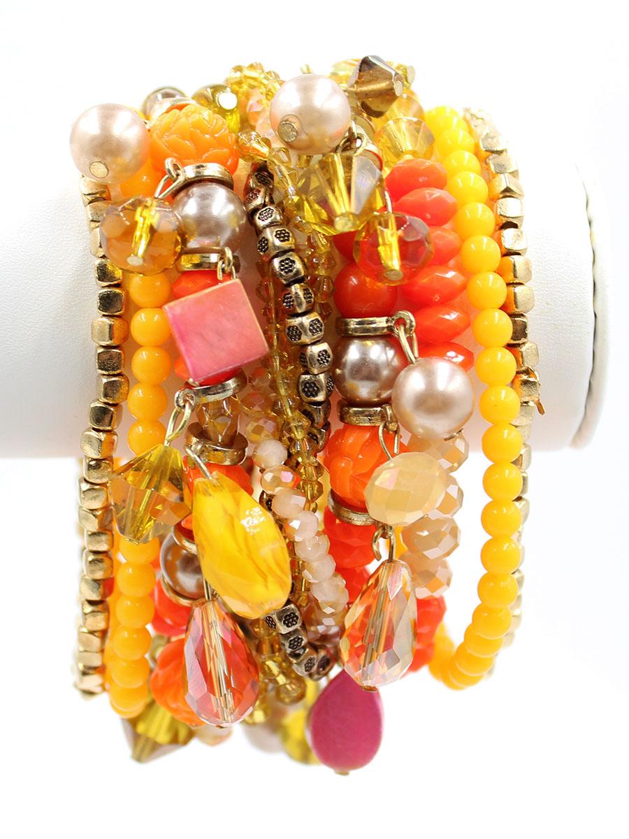 Браслет Taya, цвет: золотистый, оранжевый. T-B-11753-BRAC-GL.ORANGET-B-11753-BRAC-GL.ORANGEШирокий браслет из стеклянных бусин разнообразной огранки в сочетании с плетеной нитью из бисера выглядит броско и стильно. Магнитная застежка - удобное и современное решение, которое исключает случайное открытие и потерю браслета.