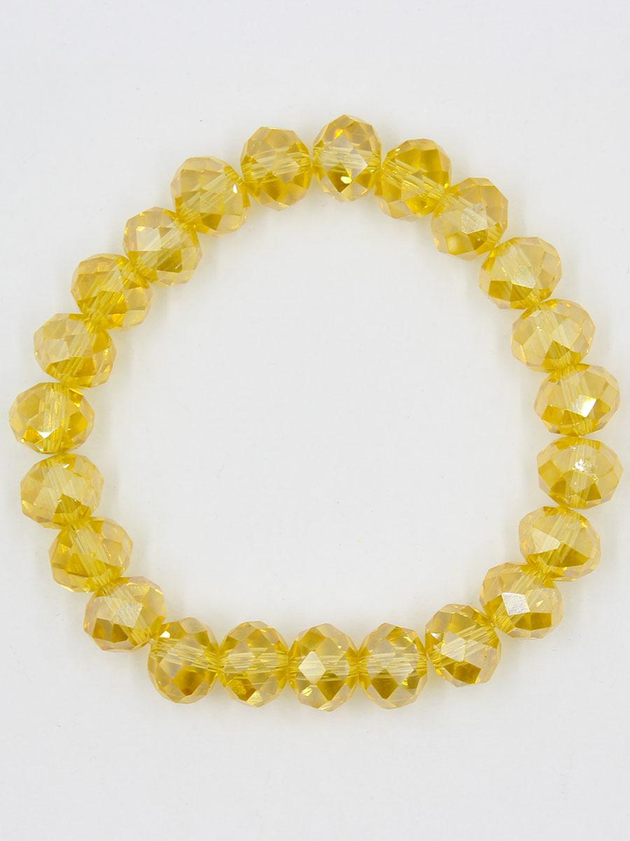 Браслет Taya, цвет: золотистый. T-B-11791-BRAC-GOLDT-B-11791-BRAC-GOLDУниверсальный однотонный браслет на резинке. Огранка кристаллов идеальная. они ярко искрятся под любым освещением.