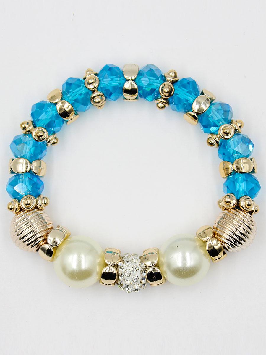 Браслет Taya, цвет: синий. T-B-11911-BRAC-BLUET-B-11911-BRAC-BLUEУдобный, современный браслет на резинке. Половина его из кристаллов и золотых перемычек, другая - из жемчужин. Можно переворачивать и носить той стороной, которая сегодня подходит под одежду.
