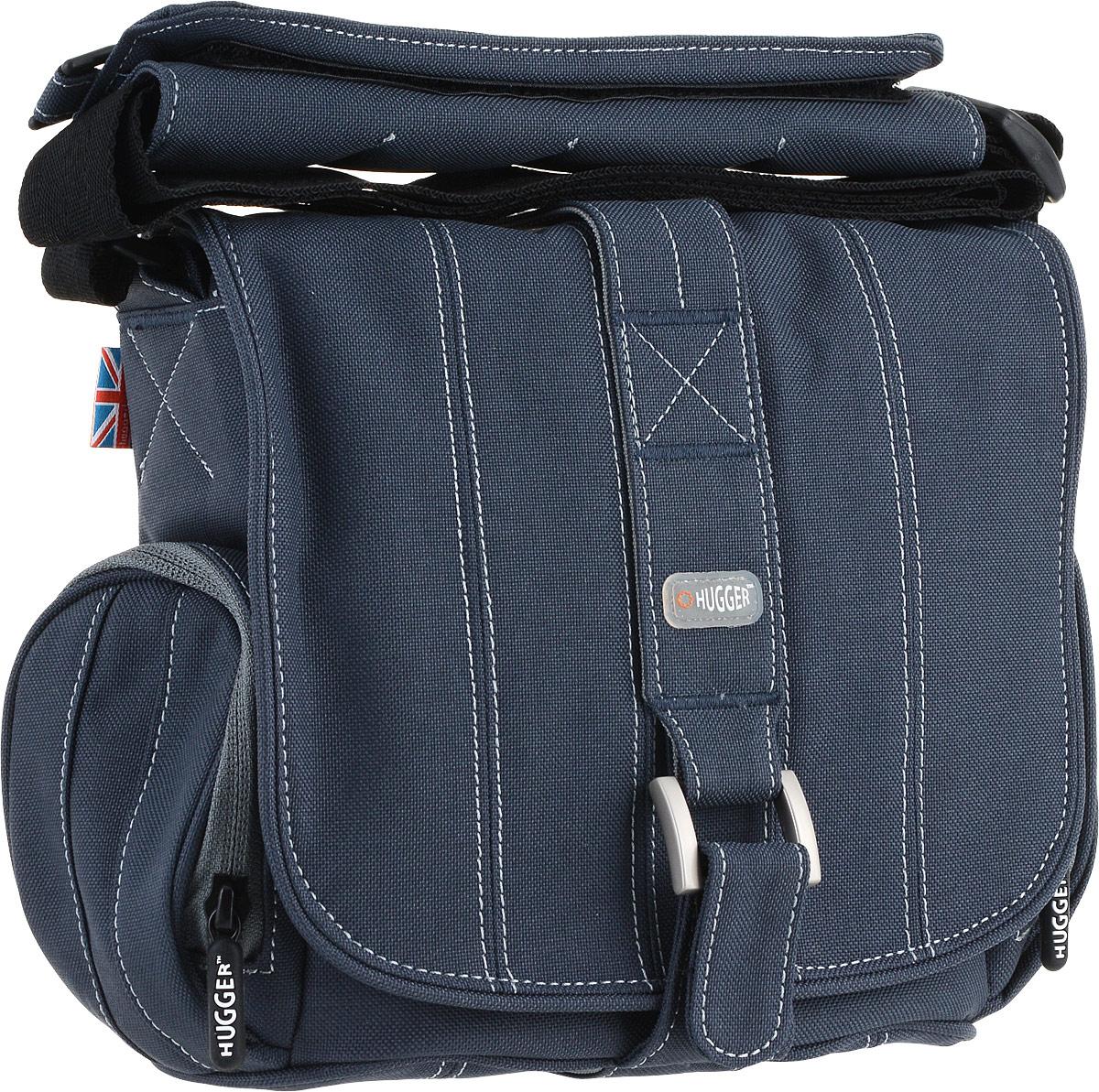 Hugger Pin-Stripe Suit, Sapphire сумка для фотокамеры2050Hugger Pin-Stripe Suit - стильная полосатая сумка, которая идеально сочетается с деловым костюмом. Передняя металлическая застежка в сочетании с лентой велкро позволяют легко застегивать верхний клапан. Мягкие внутренние перегородки могут быть удалены или перемещены для большего удобства. Передний отсек подходит для аксессуаров большого размера. Два сетчатых кармана по бокам сумки подходят для аксессуаров или личных вещей фотографа. Эта сумка подходит для зеркальной камеры с объективом и некоторым количеством аксессуаров, например, вспышкой. Съемная площадка на ремне с кольцом для мобильного телефона Толстые стенки для надежной защиты камеры от механических повреждений Высокий уровень защиты от влаги Легкий вес Противодождевой чехол и фирменный платок в комплекте