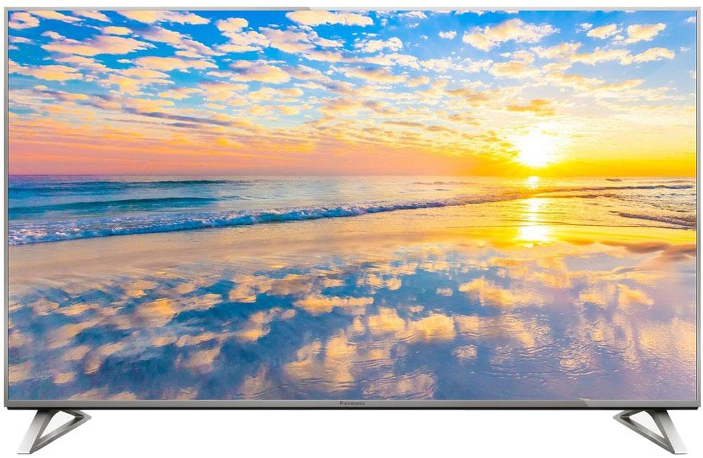 Panasonic TX-50DXR700 4K телевизорTX-50DXR700Телевизор Panasonic TX-50DXR700 обладает красочной картинкой с разрешением 4K, смарт-функциями на базе ОС Firefox, а уникальная подставка позволяет вам выбрать один из двух стилей установки. Разрешение 3840 х 2160 на 4К Ultra HD-телевизорах обеспечивает настолько детализированное и чистое изображение, что вам покажется, будто вы смотрите в окно, а не в экран телевизора. Панели с высокой яркостью и широким цветовым охватом и мощный четырехъядерный процессор Quad Core Pro гарантируют, что от вашего взгляда не скроется ни одна деталь изображения в формате 4К. HDR-совместимый телевизор Panasonic TX-50DXR700 передает ту картину окружающего мира, которая наиболее соответствует реальности. Темные цвета более глубокие, а светлые еще ярче, чем на экране обычного телевизора, что обеспечивает уровень натуралистичности, недоступный для телевидения прежде. Телевизор Panasonic оснащен передовой технологией Wide Colour Phosphor, которая расширяет цветовой...