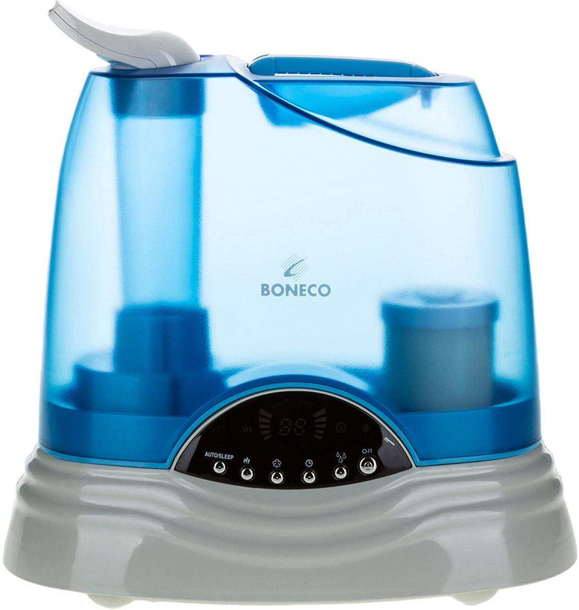 Boneco U7135 ультразвуковой увлажнитель воздухаНС-1082224Ультразвуковой увлажнитель воздуха Boneco U7135 — прибор с зеркальным дисплеем и электронным управлением, удачно сочетающий 2 вида увлажнения – «холодный» и «теплый пар». Увлажнитель Boneco U7135 экономичен с точки зрения расхода электроэнергии, работает с низким уровнем шума и удобен в управлении. К тому же, прибор оборудован встроенным гигростатом, который поддерживает заданный уровень влажности в помещении. Информативный ЖК-дисплей прибора значительно облегчит его эксплуатацию, отображая режим работы, текущую и заданную влажность в помещении. Сменный фильтр-картридж с ионообменной смолой смягчает и обеззараживает воду, а функция нагрева воды (пастеризация) гарантирует гигиенически чистый пар и повышает эффективность увлажнения. Увлажнитель Boneco U7135 самостоятельно контролирует «собственное здоровье»: в увлажнителе предусмотрен датчик загрязнения, который загорается в случае необходимости почистить прибор.